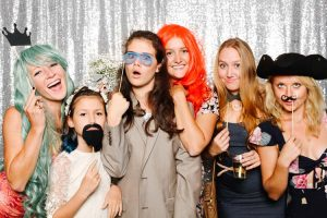 Which Photo Booth Should I Choose - girls in front of photo booth with props